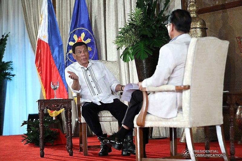 800px-President_Rodrigo_Roa_Duterte_during_a_dialogue_with_Chief_Presidential_Legal_Counsel_Salvador_Panelo_at_the_Malacañan_Palace_on_September_11,_2018._04